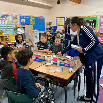 Braell Young volunteering at Vera M. Welsh Elementary School in Lac La Biche