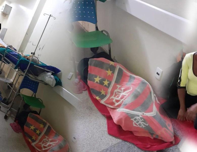 Funcionários do pronto-socorro fotografam pessoas dormindo no chão dos corredores da unidade