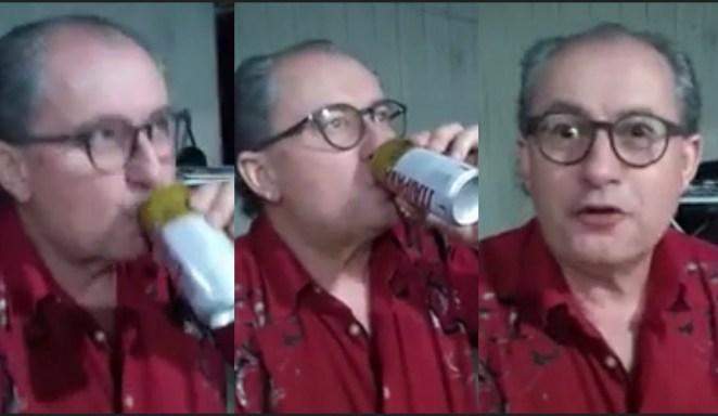 Pastor Reuel Bernardino tomando cerveja em churrasco.