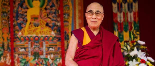 Tibet's exiled government and Buddhist spiritual leader the Dalai Lama stands on stage before making a speech to an audience at the ESS Stadium in Aldershot, southern England, Monday, June 29, 2015. Before the speech on Monday, the exiled Tibetan spiritual leader inaugurated the Buddhist Community Centre UK. (AP Photo/Matt Dunham)