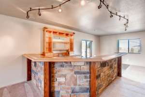 1820 Old Antlers Way Monument-small-024-16-Lower Level Family Room Bar-666x444-72dpi