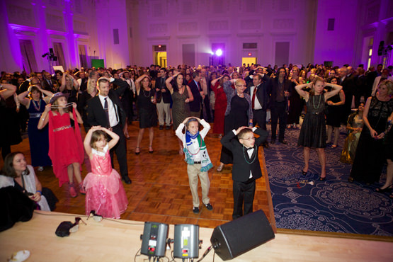 Wish Ball Guests Joined By Several Wish Kids Take Part In A Game Of Heads Or Tails The