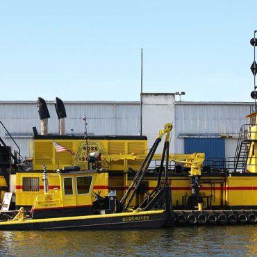 Two modern dredging boats docked at Port.