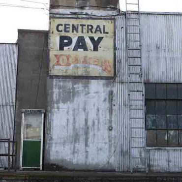 Street view of an old store sign at the port.