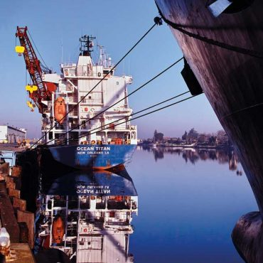 The cargo ship Ocean Titan with a large red crane.