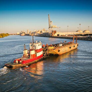 Tugboat pushing barge
