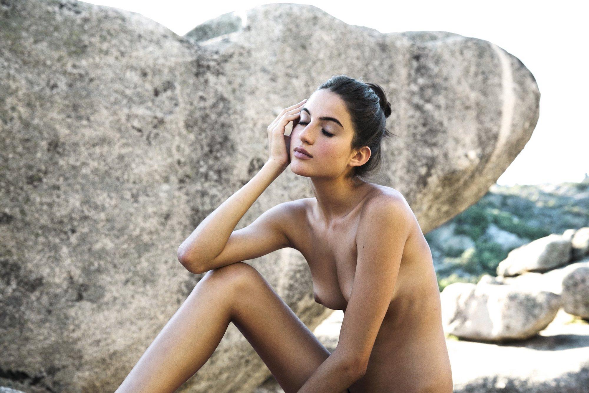 Naked women using vibrators