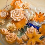 Various flowers out of orange peels