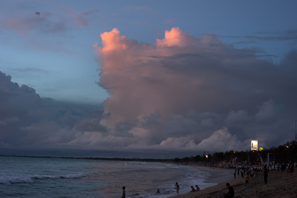 View of a Kuta beach at sunset. Kuta is a famous touristic attraction on Bali