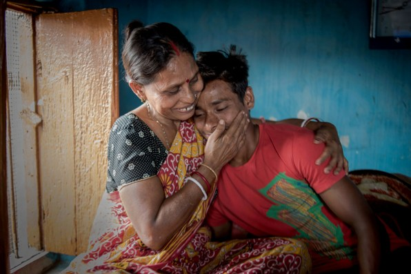 Rekha Roy, the mother of rajib, is embracing her son with sheer joy and proudness at their sonagachi residence in Kolkata. Rekha is a former sex worker and currently doing job at a bag factory near sonagachi. She earns about $50 per month and manages everything from house rent to her son's sports and educational cost.