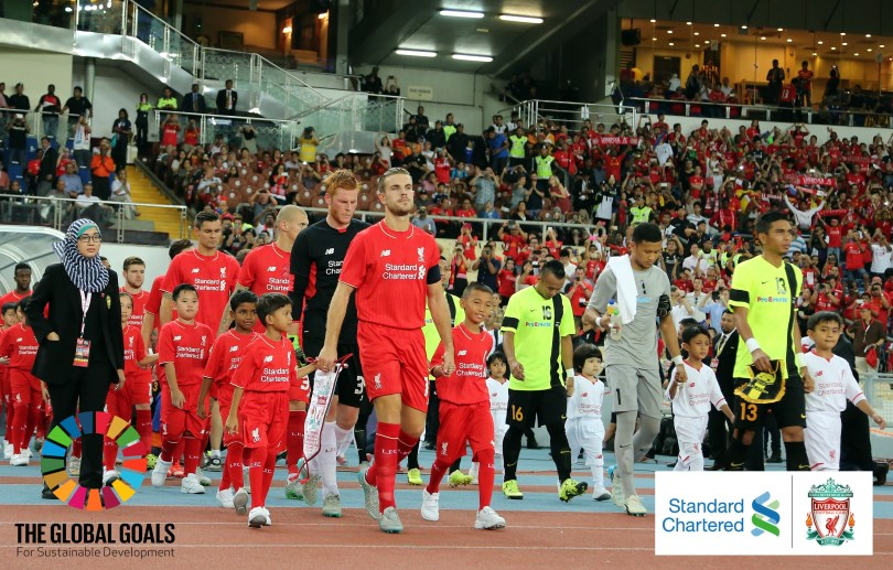 KUALA LUMPUR, MALAYSIA - JULY 24: (THE SUN OUT, THE SUN ON SUNDAY OUT) Liverpool and Malaysia XI enter the fileld prior to kick off of the international friendly match between Malaysia XI and Liverpool FC at Bukit Jalil National Stadium on July 24, 2015 in Kuala Lumpur, Malaysia. (Photo by Stanley Chou/LFC/Liverpool FC via Getty Images)