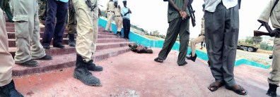 "Mogadishu, SOMALIA 24.05.2014 A member of Somalia's al-Quaeda group ""al-Shabaab"" lies dead on the ground during an attack on Mogadishu's Parliament House. Rick Findler / Story Picture Agency"