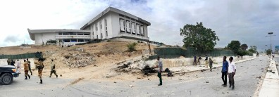 Mogadishu, SOMALIA 24.05.2014 The remains of a car bomb stand in front of Parliament House in Mogadishu during a siege by al-Shabaab militants as they took control of the building before being killed by Somali National Army and AMISOM troops. Rick Findler / Story Picture Agency