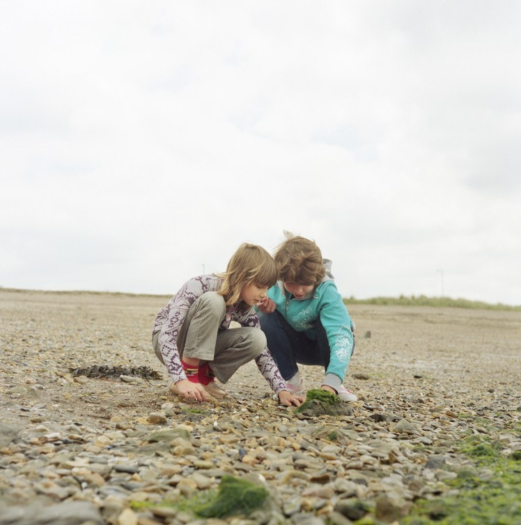 Sabina Filanovich and Anhelina Balbutskaya feel the texture of seaweed for the first time. Living in a landlocked country (Belarus) this is their first experience of the sea and the beach. The children will spend up to a month with host families around the Pembrokeshire area of the U.K. An astonishing 85 per cent of Belarusian children are deemed to be Chernobyl victims: they carry Ògenetic markersÓ that could affect their health at any time and can be passed on to the next generation. A vicious cycle that unfortunately could continue for hundreds if not thousands of years. From the series 'The Healing Land'