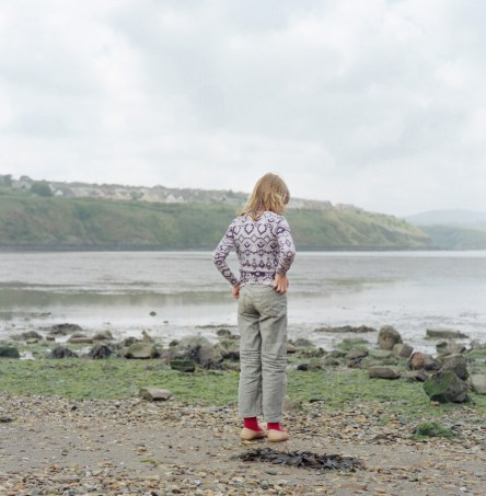 Sabina Filanovich looks out to see at the beach in Fishguard Harbour. This is the first time the children would have experienced the ocean. The children will spend up to a month with host families around the Pembrokeshire area of the U.K. An astonishing 85 per cent of Belarusian children are deemed to be Chernobyl victims: they carry Ògenetic markersÓ that could affect their health at any time and can be passed on to the next generation. A vicious cycle that unfortunately could continue for hundreds if not thousands of years. From the series 'The Healing Land'