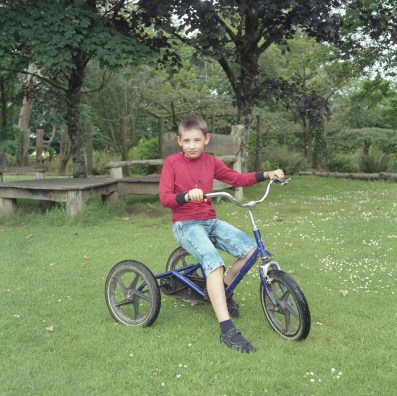Artur Dubanevick sits on his trike at the Manor House Park gardens. The children will spend up to a month with host families around the Pembrokeshire area of the U.K. An astonishing 85 per cent of Belarusian children are deemed to be Chernobyl victims: they carry Ògenetic markersÓ that could affect their health at any time and can be passed on to the next generation. A vicious cycle that unfortunately could continue for hundreds if not thousands of years. From the series 'The Healing Land'