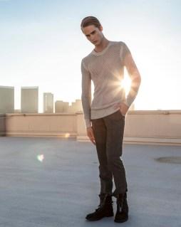 Neels wears All Saints sweater COS pants All Saints shoes