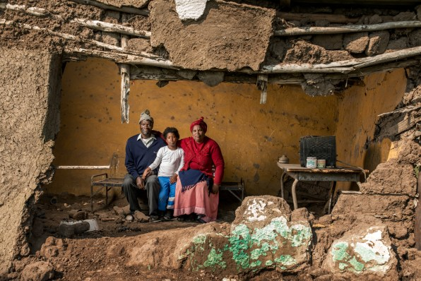 Mncedisi Dlisani with his wife Nokwakha and thier daughter Sisipho - Mr Dlisani is 59 years old and worked in the gold mines for 15 years. He developed pulmonary TB and received no compensation.
