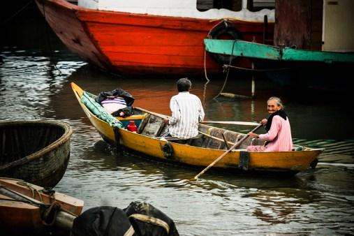 Elderly woman in a boat in Hội An