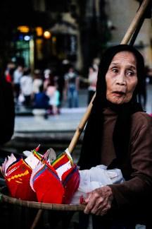 Elderly woman selling lanterns in Hội An