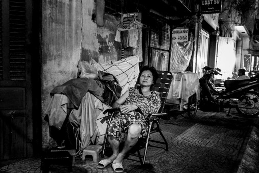 Woman resting in the evening in the streets of Saigon