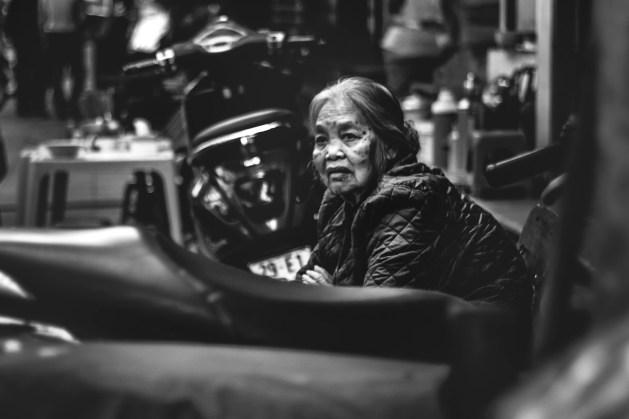 Elderly woman on the streets of Hanoi.