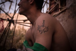 """Hamza (20) laughs as he shows his tattoos. Most of them have been made by him using a needle and some ink. When asked why he made a heart tattoo, he says that someone broke his heart. """"A boy or a girl?"""" I ask, they start laughing and Abdelatif translates to me that Hamza does not want to specify. """"A person,"""" he says. In Morocco the penalty for being gay is 3 months to 6 years in prison and fines of 120 up to 1,200 dirhams, but far greater are the social implications for the families who have a LGBT member."""