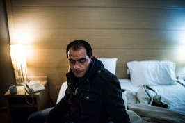 Shadi Mansour, 35 years old refugee from Syria poses inside the hotel room currently lives in central Athens. Masnour used to be a veterinarian from a small town near Aleppo, Syria. He fled Syria towards Turkey and in late December 2014 he passed the Aegean Sea by boat to arrive in Greece in order to continue his journey to western Europe.