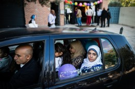 A muslim family from Egypt leaving by car the celebrations of the Eid Al-Adha in Athens, Greece. Eid Al-Adha also called the Feast of the Sacrifice is the second of two religious holidays celebrated by Muslims worldwide each year.