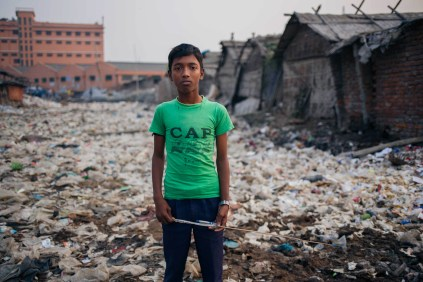 Hassan Ali, aged 11, collects leftovers from the carcasses of animals used for leather hides. He wants to work in the industry as his family has done for the past few generations and says the move to Savar will be difficult for him as he might have to relocate.