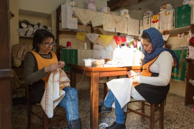 Inside the embroidery workshop where Caterina, a volunteer of Citt‡ Futura (on the left) embroidered with Tahira, from Afghanistan and from two years in Riace with her two sons.