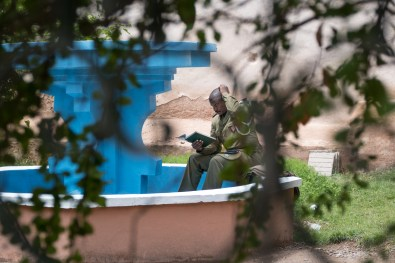In the garden of the Royal Palace in Marrakech, a soldier reads his book sitting in a fountain without water. The emancipation of women is a process that cannot fail to be accompanied by a greater awareness and sensitization of men.