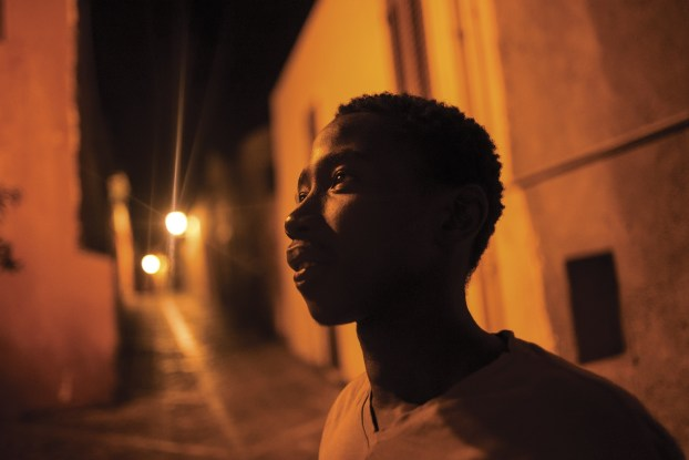 Milazzo, South Italy, 21 September 2015. Ebrima, from The Gambia, in the streets of the old town. He lives in a flat shared with other young asylum seekers, as part of the SPRAR system, which grants protection to refugees and asylum seekers.