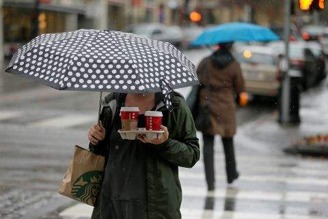 Petaluma Woman Who Had To Have Her Starbucks Despite the Heavy Rains, Assoicated Press Photo by Eric Risberg