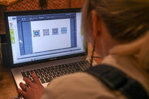 Cocoagraphs Designing Graphics To Be Transferred Onto Chocolate, Photo By Ashley Collingwood