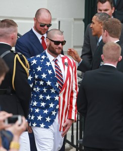(Washington, DC 04/01/2014) Boston Red Sox left fielder Jonny Gomes, wearing his bold USA flag blazer, walks past President Barack Obama at a ceremony on the South Lawn honoring the 2013 World Series Champs at the White House Tuesday, April 1, 2014. Staff Photo by Matt West.