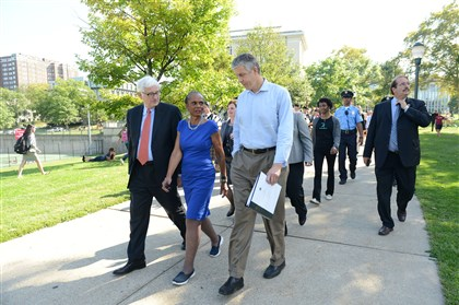 """20150918ppArneDuncan1LOCAL-8 From left, Fred Gilman, dean of Mellon College of Science, and Linda Lane, superintendent of Pittsburgh Public Schools, escort U.S. Department of Education Secretary Arne Duncan across campus to a town hall meeting Friday. The secretary was in town during a stop on the department's Sixth Annual Back-to-School Bus Tour: """"Ready for Success"""" across the Midwest."""