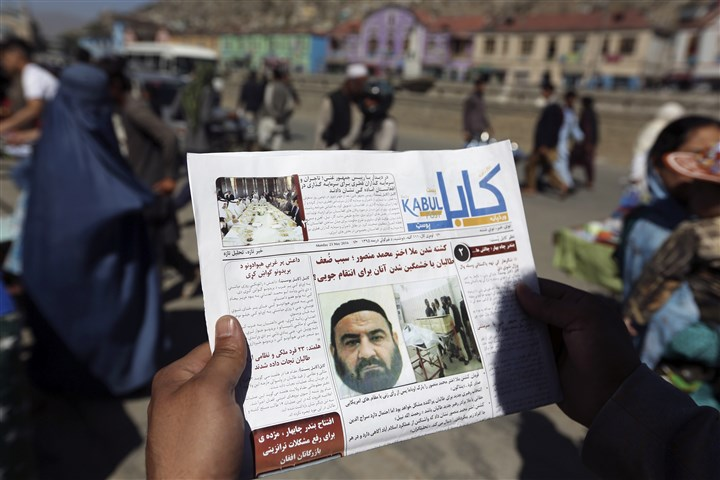 US Afghanistan In this May 25 file photo, an Afghan man reads a local newspaper with photos the former leader of the Afghan Taliban, Mullah Akhtar Mansoor, who was killed in a U.S. drone strike.