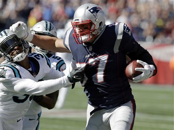 Rob Gronkowski tries to shove away Panthers defensive back Demetrious Cox after catching a pass Sunday.