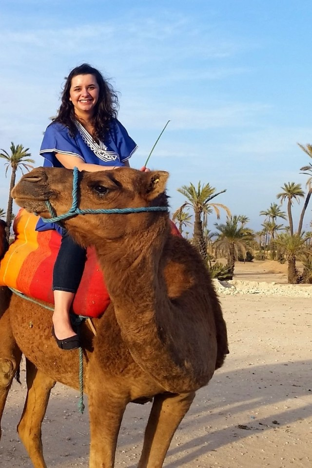 Nicole riding a camel in Marrakech, Morocco