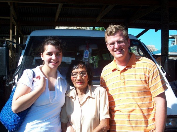 Nicole and her friend with an old woman in Donsol, Philippines