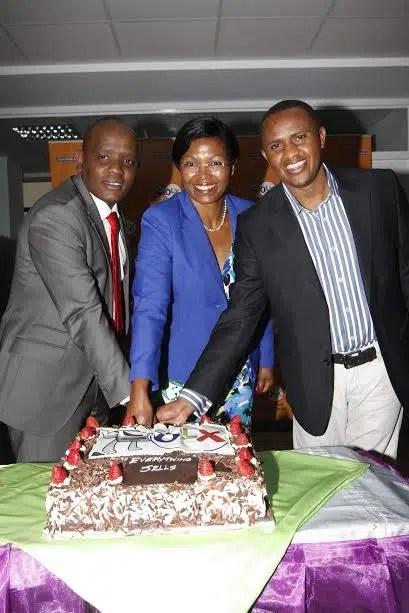 OLX Country Manager Peter Ndiang'ui (right) is joined by ICT Authority Marketing Director Eunice Kariuki (centre) and Director of Digital Communication-Office of the President Dennis Itumbi in cutting a cake to launch OLX new offices in Westlands, Nairobi on August Monday,4th, 2014. The names of meeting rooms in the new office are after the various market places in Kenya.