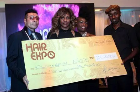 From left: Judge Farouk Jannedy, Elizabeth Ngote, winner of the weaving category as well as the overall winner holding the dummy cheque (won an all expenses paid trip to the 20th Edition of Beautyworld Middle East in Dubai), judges Mercy Ollows and Ronnie Maingi