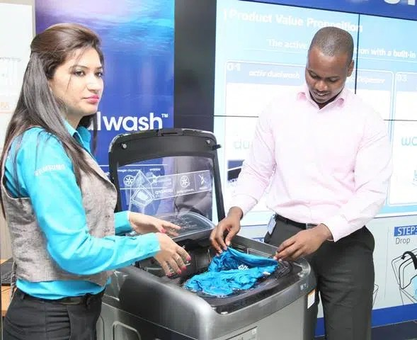 From left Shikha Monga, Marketing Manager Samsung Electronics and Ahmed Tajir, Product Manager-Washing Machine, Samsung Electronics showing how to use Activ Dual Wash Built in Sink