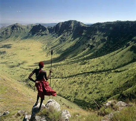 A  A Samburu warrior looks out across the eastern scarp of Africa's Great Rift Valley at Poro, Northern Kenya. Image Credit Nigel Pavitt. Image from http://www.artflakes.com/de/products/maralal-kenya-nigel-pavitt