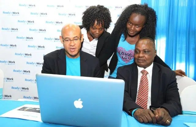 Barclays Bank Kenya, Managing Director Jeremy Awori with UON DVC of Students Affairs, Prof. Isaac Mbeche and UON students