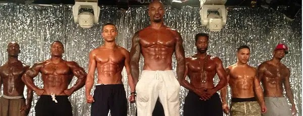 Men showing off their  muscles. Scene from the movie Chocolate City. Image from http://webcelebdaily.com/2015/04/30/chocolate-city-starring-tyson-beckford-robert-richard-and-michael-jai-white-trailer-released/#more-2992