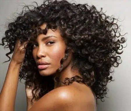 Woman wearing a weave. Image from http://madamenoire.com/198060/that-aint-no-mongolian-hair-girl-whats-the-real-deal-with-your-virgin-hair-extensions/