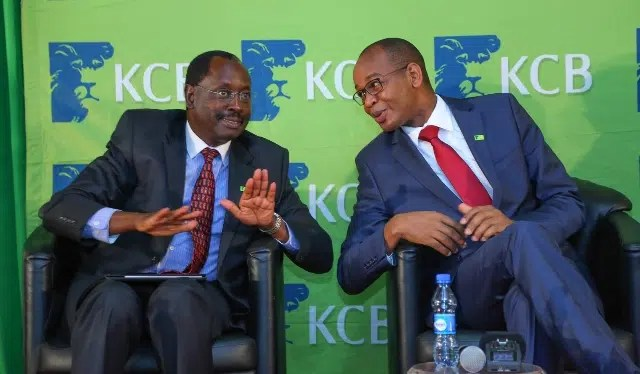 Mr. Ngeny Biwott (left) the KCB Group Chairman and Mr. Joshua Oigara (right) the KCB Group Chief Executive Officer chatting during the KCB Bank Group's 2015 full- year financial results at a Nairobi Hotel. Photo courtesy of KCB.
