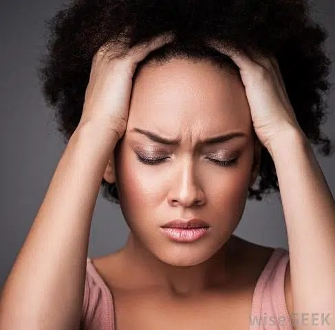 Woman with a migraine. Image from http://images.wisegeek.com/black-woman-hands-on-head-eyes-closed.jpg
